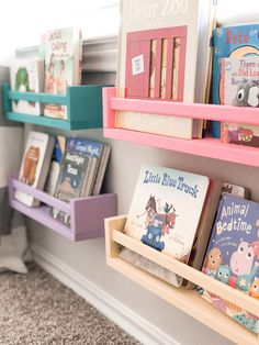 Our Playroom Tour (On a Budget) - Her Happy Home | playroom decor | playroom idea | playroom design | playroom theme | playroom ideas | playroom book storage | playroom decor | playroom storage | playroom organization | book storage| bright playroom | colorful playroom | ikea book shelves | ikea spice racks | ikea hack | kids book storage