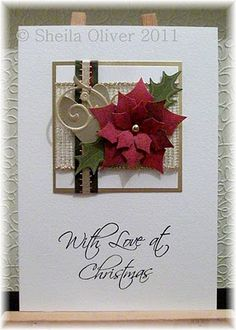 Spellbinders Poinsettias, Heart and swirl are Sizzix Sizzlit dies and the holly leaves are punched and edged with gold pen
