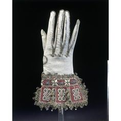 Pair of gloves 1600-1625 kid leather and satin, embroidered with silk, silver gilt threads and seed pearls with silver gilt bobbin lace and spangles