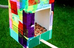 Fun idea for upcycling a milk carton and making a colorful bird feeder by Rhythm of the Home