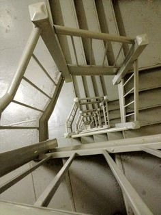 The view into the downward abyss created by select gray apartment building stairwells should never go unnoticed.