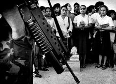 """Catholic nuns form the first line of defense where Marcos troops face """"People Power"""" protesters in this 1986 photo"""