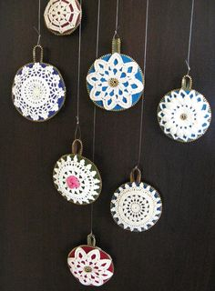 Vintage Doily Ornaments by Woolly Fabulous (Odile Gova).  She does such amazing work with felt, zippers and doilies!