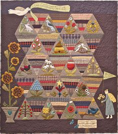 "How Does Your Garden Grow?  52 x 59"", felted wool applique folk art quilt with pieced triangle blocks.  Pattern by Norma Whaley 