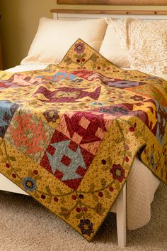 Churn Dash quilt, in: Simple Graces by Kim Diehl at Martingale