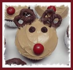 Reindeer Cupcakes - Red peanut butter M for the nose, Chocolate chips for the eyes, Chocolate covered pretzels for the antlers, One container of ready made vanilla frosting mixed with brown food coloring