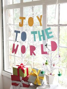 Spread some fa-la-la cheer around your home! Make it! Cut letters out of bright index cards and punch two holes on the top of each letter. String a thin cord through each letter and hang over your mantel, on a wall, or in a window.