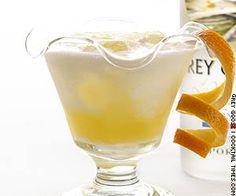 Vanilla Creamsicle   (1 oz vanilla vodka - 1 oz Grey Goose L'Orange - 3 oz Orange juice - 1/4 oz triple sec - fresh cream Garnish: orange peel)