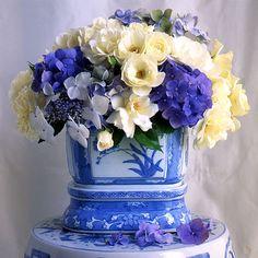 beautiful blue florals in B & W vase.