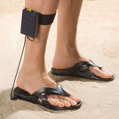 Um...WHAT!? The Metal Detecting Sandals.   These are the sandals that can detect metal while you walk, allowing you to find buried artifacts while strolling the beach.