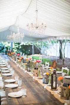 Tent and chandeliers make for a dreamy wedding.