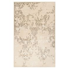 Anchor your living room decor or define a space in your master suite with this elegant rug, hand-tufted of New Zealand wool and featuring a floral motif.