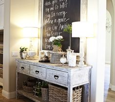 Gray washed buffet console table, framed chalkboard, woven baskets and alabaster lamps