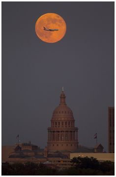 The Harvest Moon rises over the Capitol in Austin, Texas, on Monday Sept. 12, 2011. Photo by Jay Janner/Austin American-Statesman