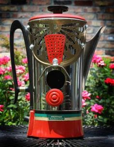Recycled coffee pot birdhouse