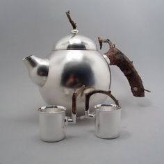 Teapot in silver with two cups by Klara Eriksson