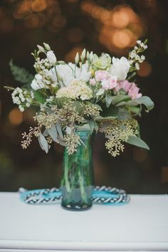 romantic floral centerpiece, photo by By the Robinsons http://ruffledblog.com/sunken-gardens-florida-wedding #flowers #weddingcenterpieces