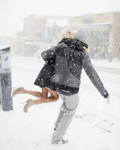 Like the dedication - heels in the snow - and the chivalry. Such a cute photo!