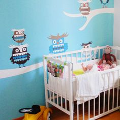 Blue nursery with a feature wall from ISAK #nursery