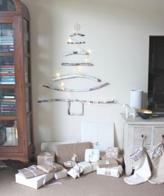 Painted-Stick Christmas Tree from Happy Home (great for small spaces) #christmas #tree #holiday #decorations