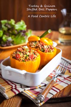 Here's my updated recipe for stuffed bell peppers with lean ground turkey, nutrition-packed quinoa, tomatoes, sweet dried currants, warming spices, plus a little feta cheese for some tang. You can even make the stuffing ahead of time to save time. A healthy dinner! Just add a tossed green salad. For vegetarians, use your favorite bean instead of the turkey.