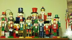 a portion of my husband's nutcracker collection displayed on the entertainment center because my nutcracker collection takes up the whole mantle