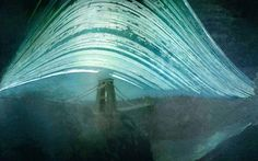 A photo by Justin Quinnell of the sun's pathways from a 6 month long pinhole exposure.  The highest arc is the summer solstice, the lowest is the winter solstice, and the lines that are not continuous are from cloudy days when the sun only poked through now and then.
