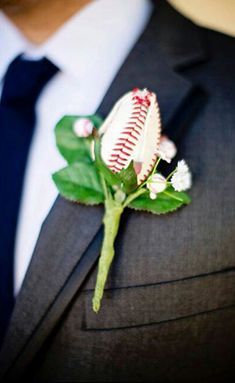 Pair these Baseball Rose Boutonnieres with a set of baseball cufflinks and your groomsmen are set!  #baseballwedding  #stwdotcom