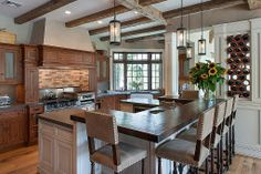 Call your friends over! With appliances, bar counter and wine rack all in sight, this rustic kitchen is ideal for entertaining.