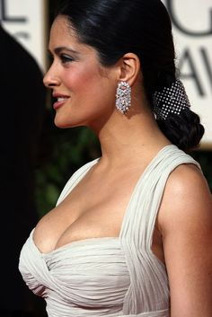Salma Hayek killer cleavage in a low cut and tight white dress