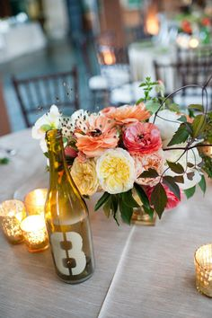 painted bottles used for table numbers. lovely centerpiece