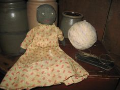 Sweet little black doll with early dress...... sweetanniesantiques.wix.com/sweetannies