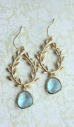 "#JEWELRY: ""A little touch of blue (this could be your something blue) in these gemstones for earrings, paired with lovely antique gold leaf design. Could work very well with a Grecian styled gown."""