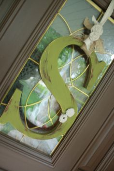 Door initial instead of a wreath - love the initial!
