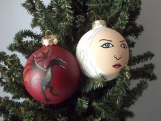 Winter is coming... time for Game of Thrones Ornaments! Daenerys Targaryen and Dragon have been hand painted on glass ball ornaments!
