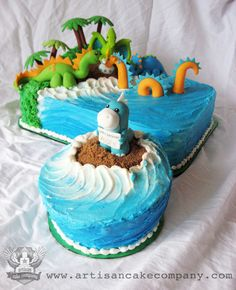 Dinosaurs on land and sea birthday cake