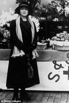1915: Future wife of King George VI, Lady Elizabeth Bowes-Lyon (Queen Elizabeth the Queen Mother) as a stallholder at a wartime Red Cross bazaar.