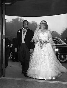 Florida Memory - African American bride being escorted during wedding in Tallahassee, Florida. 1954
