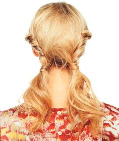 To do: Part your hair down the middle in back, then twist the hair on each side of the part tightly toward your nape. Hold each twist in place with an elastic at the base of your neck. Hide both elastics with a strand of hair from each ponytail, securing the wrapped strands with a bobby pin (this will also help keep the twists from unfurling).