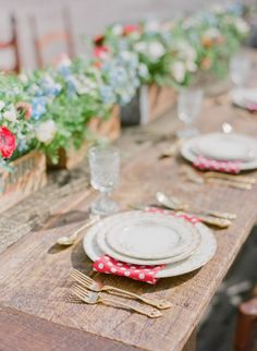 Brunch table with bamboo plates & silverware arrangements in wooden wine boxes