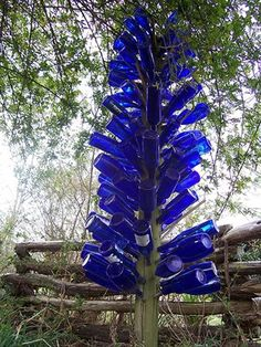 In Gullah areas of the south, the color blue is most significant.  It is the color to ward off evil spirits.  Many houses have the window and door trims painted this bright blue.  Most bottle trees will have the blue bottles.