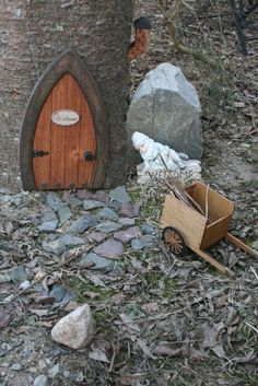 This is so cute with the Welcome sign on the door and the little fairy chimney, in addition to the pebble pathway leading to the tiny door.