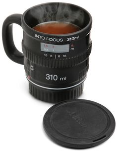 """Features    Ceramic coffee lens mug  Heat resistant. Keeps from scalding your fingers  310 ml capacity (approximate 10 ounces)  Perfect for the combination photographer / coffee fiend  Comes with rubber """"lens cap""""  Dishwasher Safe"""