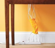 Storage - Corral cords with a sock. | 34 Ingenious Ways To De-Clutter Your Entire Life