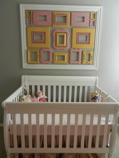 This #yellow and #pink gallery wall is a girly touch in the #nursery.  #gallerywall