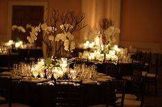 Black table linens with lots of candles