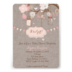 Super cute baby shower invitation with hanging mason jars and beautiful flowers on a brown linen background.