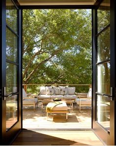 Love the large glass black french doors to the outdoor area! - http://pinhome.net/deck-patio-outdoor/love-the-large-glass-black-french-doors-to-the-outdoor-area/