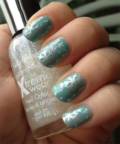 Light teal with silver metallic snowflakes winter nail art. #nails #nailart #manicure