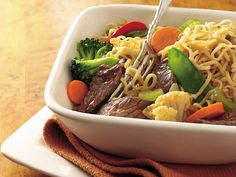 Easy Ramen Noodle Bowl:  2 teaspoons vegetable oil 1 lb boneless beef sirloin steak, cut into thin strips 2 cups water 1 package (3 oz) Oriental-flavor ramen noodle soup mix 1 pkg (1 lb) fresh stir-fry vegetables (broccoli, cauliflower, celery, carrots, snow pea pods and bell peppers) (4 cups) 1/4 cup stir-fry sauce easi ramen, noodles, ramen noodl, bell peppers, noodl bowl, fun recip, beef dinners, bowls, kid